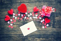 Paper Heart and gift box on wooden background / Various sizes pink and red heart Valentines day letter stock photos