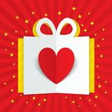 Paper heart in gift box with yellow flare, stars Stock Photo