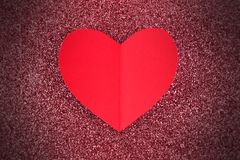 Paper heart on glittery background Stock Photo