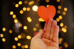 Paper heart in hands. Heart in hands conceptual image. Heart suggestion and love stock images