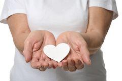 Paper heart in hands Stock Photo