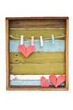 Paper heart hanging on the clothesline. On old wood background. stock images
