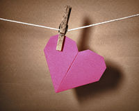 Paper heart hanging on a rope Royalty Free Stock Images