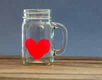 Paper heart in jar Stock Images