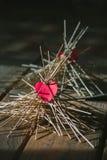 The paper heart lies on the wooden sticks. idea. The paper heart lies on the wooden sticks. conceptual. idea stock image