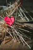 The paper heart lies on the wooden sticks. idea. The paper heart lies on the wooden sticks. conceptual. idea royalty free stock photo