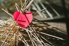 The paper heart lies on the wooden sticks. idea. The paper heart lies on the wooden sticks. conceptual. idea royalty free stock images