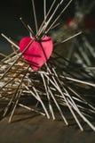 The paper heart lies on the wooden sticks. idea. The paper heart lies on the wooden sticks. conceptual. idea stock photography