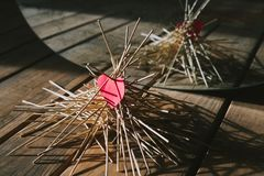 The paper heart lies on the wooden sticks. idea. The paper heart lies on the wooden sticks. conceptual. idea royalty free stock photography