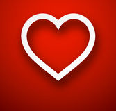 Paper heart over red. Stock Image