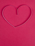 Paper heart on pink paper Royalty Free Stock Photography