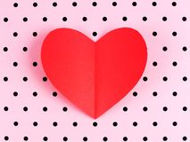 Paper heart on polka dot background Stock Image