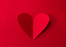 Paper heart on red background Royalty Free Stock Photos