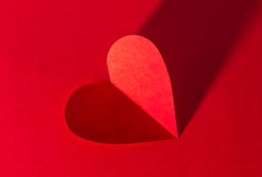 Paper heart on red background Stock Photos