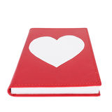 Paper heart on red book isolated on white background. Selective focus Royalty Free Stock Photo