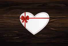 Paper heart with a red bow and ribbon. Valentine`s Day. Greeting. Card. Empty space for your ad or inscriptions. Vector illustration on a wooden background Royalty Free Stock Photo
