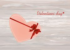 Paper heart with a red bow and ribbon. Valentine`s Day. Greeting. Card. Empty space for your ad or inscriptions. Vector illustration on a wooden background Stock Image