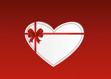 Paper heart with a red bow and ribbon. Valentine`s Day. Stock Photos