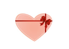 Paper heart with a red bow and ribbon. Valentine`s Day. Royalty Free Stock Images