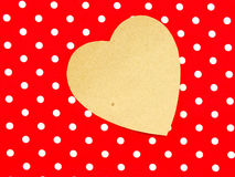 Paper heart on red polka dot background with gift Royalty Free Stock Photos