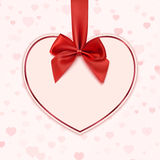 Paper heart with red ribbon and a bow Royalty Free Stock Image