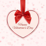 Paper heart with red ribbon and a bow Royalty Free Stock Images