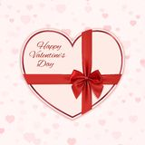 Paper heart with red ribbon and a bow Stock Photos