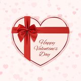 Paper heart with red ribbon and a bow Stock Image