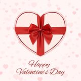 Paper heart with red ribbon and a bow Stock Photo