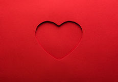 Paper heart. Red paper with heart shaped hole with deep shadow Stock Photography