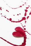 Paper heart and red splashes Royalty Free Stock Image