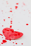 Paper heart and red splashes Stock Images