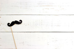 Paper heart shape fake mustaches in sticks Royalty Free Stock Photo