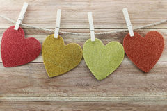 Paper Heart shape hanging on a hemp rope on brown wood backgroun Royalty Free Stock Photo