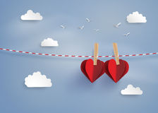 Paper heart shape hanging on the lope. With blue sky.paper art style vector illustration