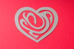 Paper Heart Shape with Ornament on Red Background Stock Photos