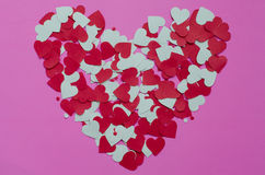 Paper Heart Shape On Pink Background. Background of paper hearts shape on pink for Valentine's day Stock Image