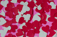 Paper Heart Shape On Pink Background. Background of little piece of paper hearts shape on pink for Valentine's day Royalty Free Stock Images