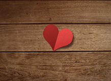 Paper heart shape on wood table Royalty Free Stock Photography