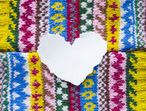 Paper heart with space for text on a colored textile background. Valentine with love.  Royalty Free Stock Images