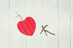 Paper Heart and Three Rusty Nails Royalty Free Stock Photos