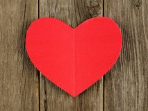 Paper heart on wood background Stock Photography