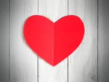 Paper heart on wood background Stock Images