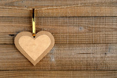 Paper heart on wood Royalty Free Stock Photos