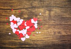 Paper Heart on wooden background / small pink and red heart Valentines day for lover royalty free stock image