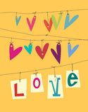 Paper hearts. Colourful paper hearts hanging from lines Royalty Free Stock Photography