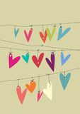 Paper hearts. Colourful paper hearts hanging from lines Royalty Free Stock Image
