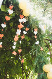 Paper hearts with a balloon at the wedding arch Stock Image