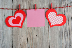 Paper hearts and blank note Stock Photo