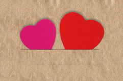 Paper hearts on brown background, close up Royalty Free Stock Images